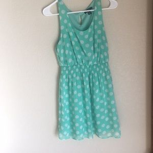 Green and white polka dot dress